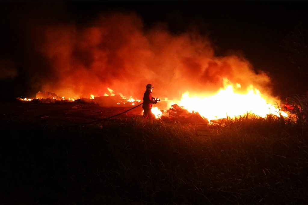 Firefighter trying to stop a bushfire in Malacca, Malaysia. Bushfires, Climate Change and the Lessons From the Past Decade